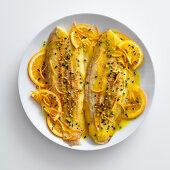 Sole fillets in saffron orange sauce with pistachios