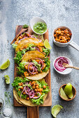Tacos with hot chickpea and cauliflower salsa, lettuce, onion and guacamole