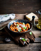 Penne puttanesca with parmesan and basil