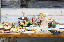 A breakfast buffet with homemade delicacies served in a pasture
