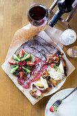 Snacks Plate with fresh salad, meat carpaccio, cheese