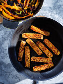 Pan fried marinated tofu with pan fried peppers and onions