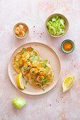 Uttapam (fermented rice pancakes, India) with prawns