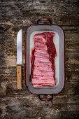 Beef ribs in a roasting tin