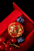 Buche de Noel with berries and gold leaf
