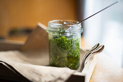 Pesto verde made with parsley, mint and walnuts in a jar