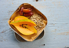 Papaya, dates and sunflower seeds