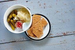 Gherkins, sauerkraut, pomegranate seeds and crispbread