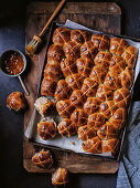 Salted peanut butter and jelly-glazed hot cross buns