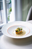 A potato and crisps with a duo of kelp and caviar