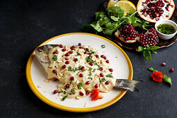 Samke Harra - Lebanese spicy fish with tahini sauce, pomegranate seeds and almonds