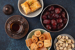 Traditional Arab fresh hot tea time with sweets, baklava, dates and lokum