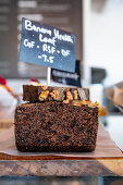 Dark banana bread with nuts on a restaurant counter