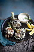 Artichoke tempura with a yoghurt and anchovy sauce and lemon