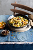 Spaghetti with orange, anchovies, olives and fennel