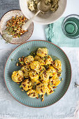 Tortellini with artichoke and potato filling and anchovy pine nut oil