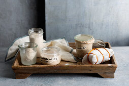 Sourdough batch with different types of flour in glass jars