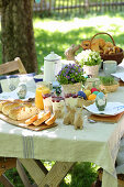A covered easter table in a garden