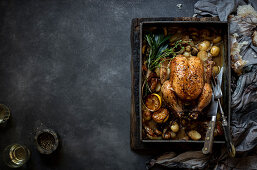 Roast chicken with baby potatoes and portabellinis