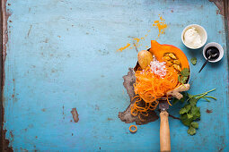 Ingredients for pumpkin stew with carrot spirals, zoodles and potatoes