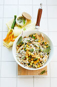 Rice bowl with chicken breast, zucchini and sage