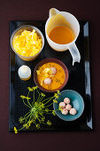 Pumpkin and coconut soup with shrimp dumplings and fennel flowers
