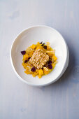 Arctic char fritter with pine nut and pumpkin risotto