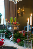 Arrangement of hyacinths in silver urn and juniper branches decorating table