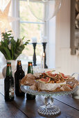 Serving plate of cheese and figs on table in country-house kitchen