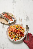 Oven salmon on spaghetti with vegetables