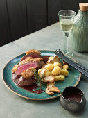 Lamb loin with mushroom and tomato crust and gnocchi