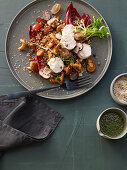 Spicy lentil and mushroom salad with grapes and goat cream cheese