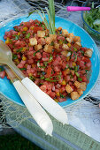Colourful summer salad with tomatoes, peppers and croutons