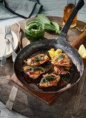 Saltimbocca in a rustic pan with wild garlic pesto