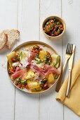 Zucchini carpaccio with ham