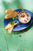 Oriental curd dip with pomegranate