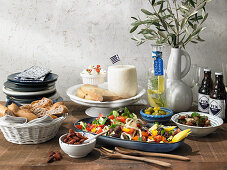 A table laid with Greek dishes