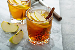 Apple cider old fashioned cocktail with cinnamon