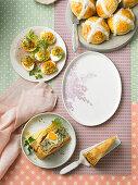 International Easter buffet: stuffed eggs, hot cross buns and tora pasqualina