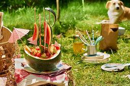 A decorative fruit 'ship' for a picnic