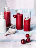 Cherry and coconut slush in slim glasses