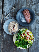 Grilled duck breast, fennel and apple salad with pomegranate seeds and cinnamon rice