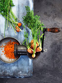 Carrots in a mincer