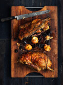 A duck with apple and plum stuffing for Christmas dinner