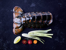 A lobster tail on a dark surface