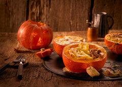 Stuffed Hokkaido pumpkins with potato gratin and mushrooms