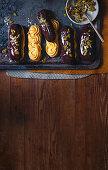 Pumpkin and chocolate eclairs