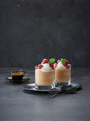 Coffee mousse with whipped cream and raspberries
