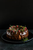 Chocolate cake with cranberries and rosemary for Christmas