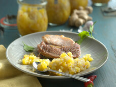 Pineapple and cucumber chutney as an accompaniment to meat